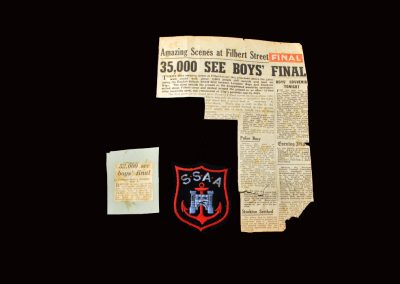 Newspaper reports and team badge
